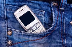 Cell phone in pocket Stock Image