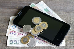 Cell phone and polish money Royalty Free Stock Photo