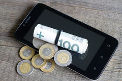 Cell phone and polish money Stock Photo