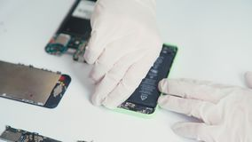 A cell phone repair. The internal components of a smartphone