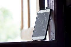 Cell phone screen has cracks. stock photo