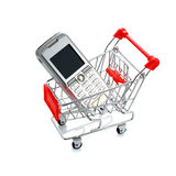 Cell phone in shopping cart isolated royalty free stock image