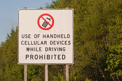 Cell Phone Sign. Sign - Use of handheld cellular devices while driving prohibited Stock Images
