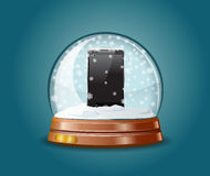Cell phone in snow globe. Stock Image