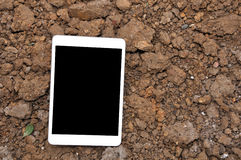 Cell phone On Soil Surface. Royalty Free Stock Images