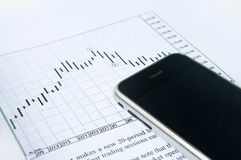 Cell phone with stock chart. Cell phone with candle stick chart Stock Photos