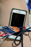 Cell phone stuck in bikini straps Royalty Free Stock Photo