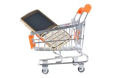 Cell phone in supermarket pushcart isolated on white background Royalty Free Stock Photos