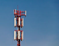 Cell Phone Tower. Wireless technology - mobile cellural phones development. People contact business Royalty Free Stock Image