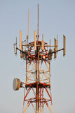 Cell phone tower antenna. A communication tower which is used for broadcast or two-way communications via radio waves; such as radio, television, cellphones and royalty free stock image