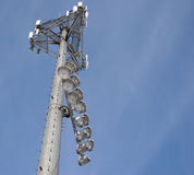 Cell Phone Tower with Ballfield Lights. Cell phone tower and baseball field lights with a nice looking sky Stock Images