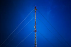 Cell phone tower with blue sky Stock Photos