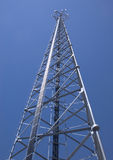 Cell Phone Tower Reaching The Sky Royalty Free Stock Photos