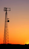 Cell Phone Tower Silhouette. A cell phone tower silhouette in the sunset Royalty Free Stock Image