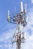 Cell Phone Tower with White Cloud and Blue Sky Stock Photo