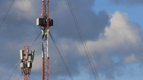 Cell phone towers. In convection currents and clouds stock video footage