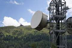 Cell phone transmitters on telecommunication tower in mountains Royalty Free Stock Photos