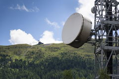 Cell phone transmitters on telecommunication tower in mountains Stock Photos