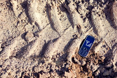 Cell phone on tread. Cell phone continue working on tread Stock Image