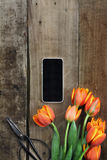 Cell Phone and Tulips Stock Images
