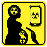 Cell Phone Use and Pregnancy. Radiation from Smartphone can harm the brain of the unborn Stock Image