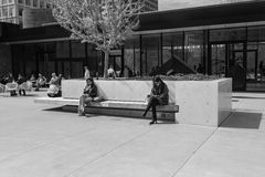 Cell phone users outside museum Black and White Stock Photography