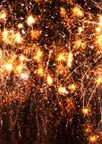 Cell phone wallpaper gold exploding fireworks black background. An abstract mobile cell phone or ipad wallpaper background of gold, sparkling , exploding showers Royalty Free Stock Images