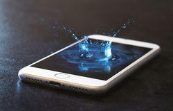 Cell phone and water splash Royalty Free Stock Images