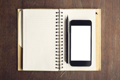 Cell phone with white screen and diary Stock Photos