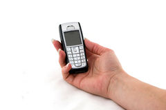 Cell phone in womans hand Royalty Free Stock Photo