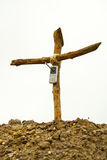 Cell phone on wooden cross Stock Image