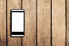 Cell phone on wooden table texture background Stock Photo