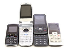 Cell phones. Old cell phones in a row Royalty Free Stock Photos