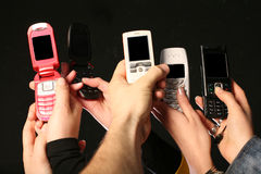 Cell phones in hands Stock Photo