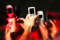 Cell phones in hands Royalty Free Stock Photo