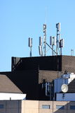 Cell site aerials on high rise building Royalty Free Stock Photos