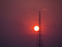 Cell Site Behind The Sun Stock Image