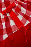 Cell textile background. White and red cell textile texture with a red button and a bow on it Royalty Free Stock Image
