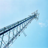 Cell Tower. A cell tower reaches into a blue sky Stock Photo
