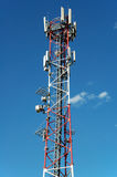 Cell tower. Big communication tower with GSM and microwave antenna royalty free stock photography