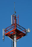 Cell tower. With blue sky in background Stock Photo