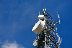 Cell Tower With Microwave Dishes At A Low Angle.  Stock Photos