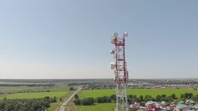 Cell Tower. City communications. Aerial shoot. Cell tower in red and white. City communications. Summer time. Aerial filming stock video