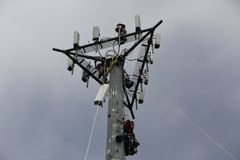 Cell Tower Workers Royalty Free Stock Image