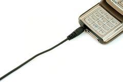 Cella o telefono mobile che è caricato Fotografia Stock Libera da Diritti
