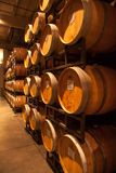 Stacked oak barrels of Cabernet. Kept at a constant temperature in a humidity and temperature controlled building Aging wine in French and American Oak barrels Royalty Free Stock Image