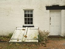 Cellar Door. This is a shot of an old cellar door on an old colonial building Stock Images