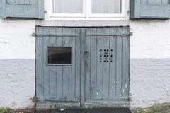 Cellar door in a building in Bruges.  Stock Photo