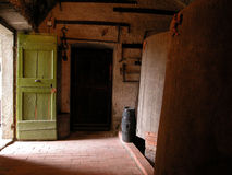 Cellar with entrance door with red wood Royalty Free Stock Photography