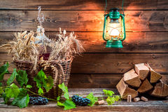 Cellar full of homemade wine. On old wooden table Stock Photos